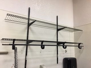 WIRE SHELVING. SCREWED TO WALL. RECOMMENDED TI BRING PHILLIPS HEAD SCREWDRIVER AND STEP STOOL 48H X 72W X 14D
