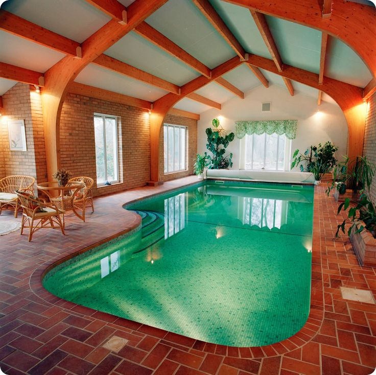 Lovely house indoor pool design with round corner pool shape and mosaic pool tiles also retro