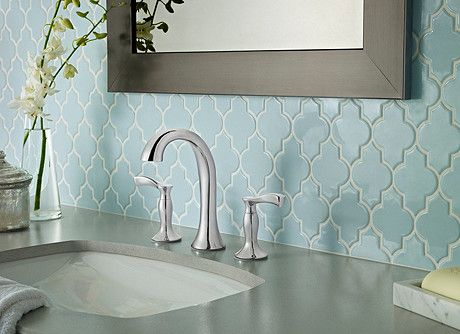 Varying the tile in the bathroom adds textural beauty and a subtle pattern punch. Beautiful Morrocan-inspired tiles give this modern bathroom a lush, worldly vibe. The sleek and elegant faucet mimics the tiles' motif, completing the look of simple elegance. ***Cassano Widespread Faucet in Polished Chrome