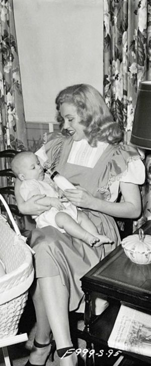 Marilyn in a babysitting publicity photo for Fox Studios, 1947. Photo by David Cicero.
