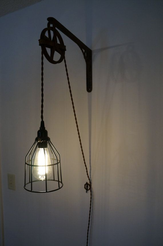 Vintage industrial light the mounting arm is a antique rustic shelf bracket the pulley