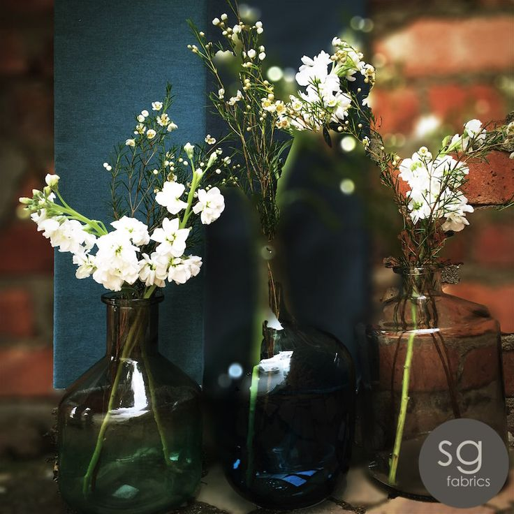 INDUSTRIAL TEXTURES -  This look works just as well against more industrial textures, such as concrete or exposed brick.Group bottle vases on a table against a brick wall, this makes for a stunning texture comparison with the glass.