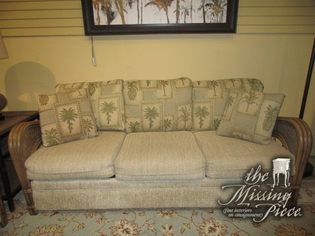 """Tropical style queen sleeper sofa in a tan upholstery on medium toned rattan frame. This sofa has palm print accent pillows. At posting, we have the matching loveseat. 79""""long x 35""""deep x 36""""high."""