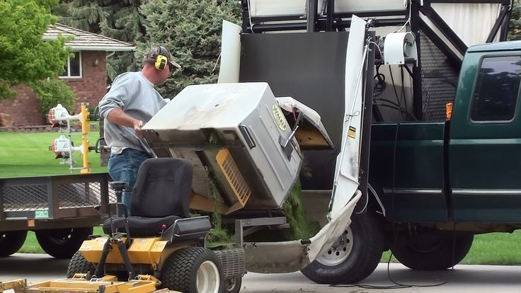 Loading Lawn Debris Into The Lift Mechanism From The Mower