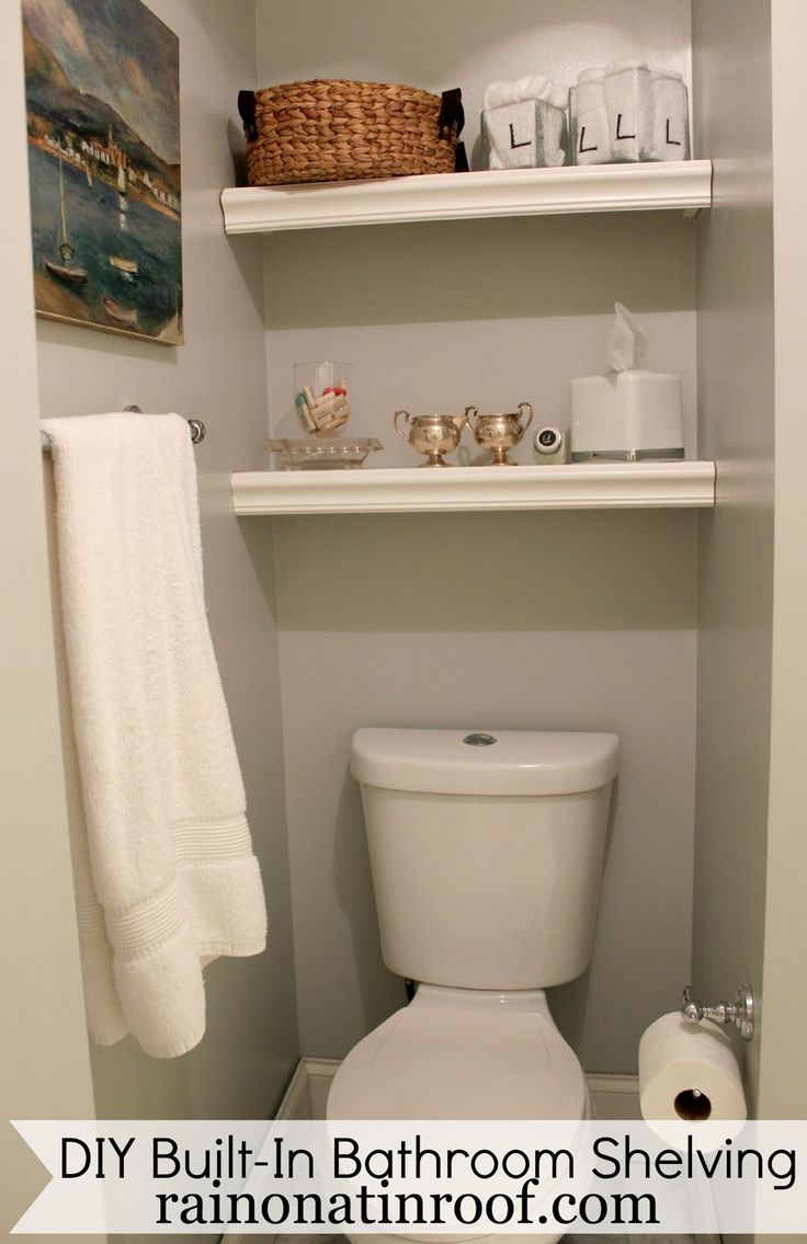 That wasted space above the toilet? Use it!! These shelves cost less than $25 to make and took less than an hour to build! DIY Built-In Bathroom Shelving via RainonaTinRoof.com