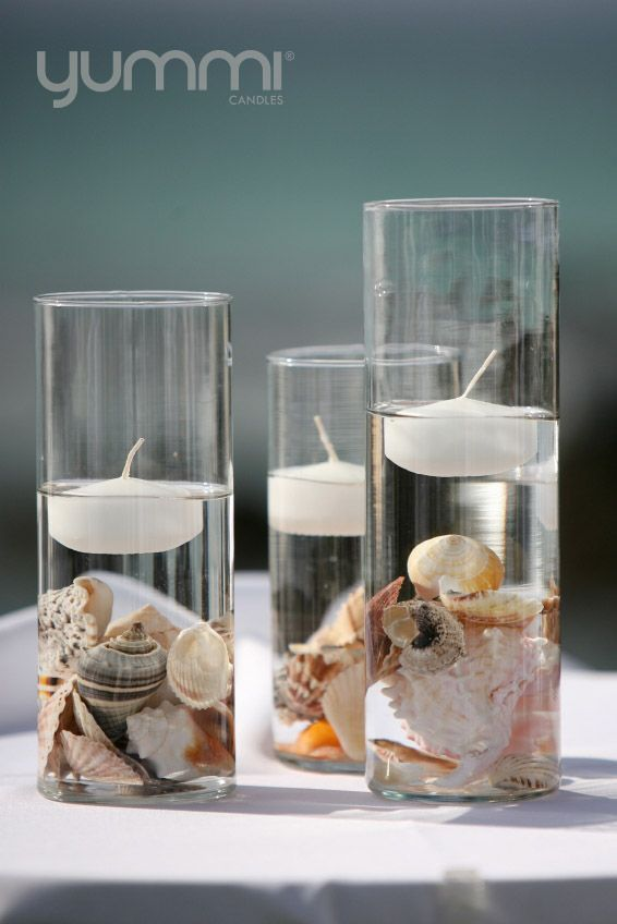 Floating candles with sea shells at the bottom