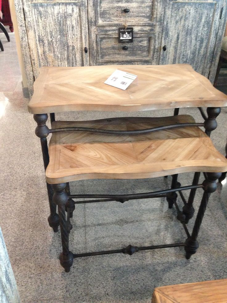 These are fantastic nesting table. Love the old wood construction with the black metal legs.