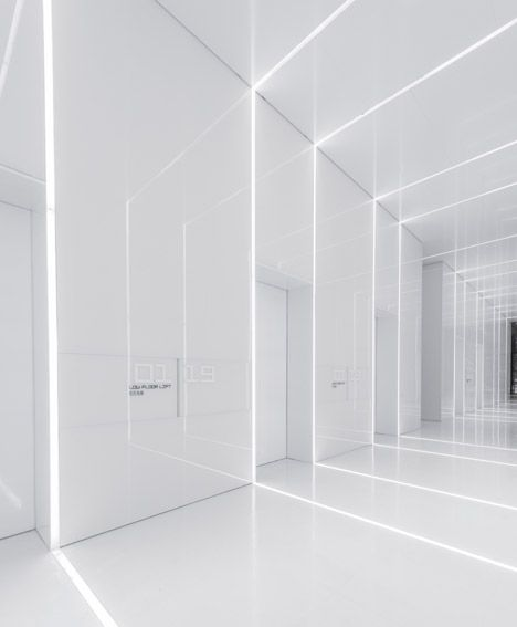 All-white corridor. Soho Fuxing Plaza by Aim Architecture.