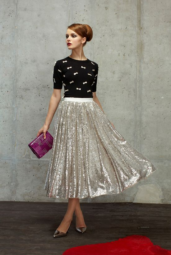 Shop this look for $96: http://lookastic.com/women/looks/black-and-white-crew-neck-sweater-and-silver-midi-skirt-and-purple-clutch-and-silver-pumps/2605 — Black and White Embroidered Crew-neck Sweater — Silver Pleated Sequin Midi Skirt — Purple Leather Clutch — Silver Leather Pumps: