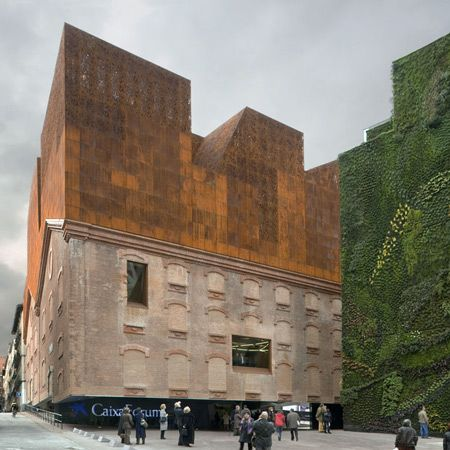 The CaixaForum arts centre, which opened earlier this year in Madrid, Spain, incorporates walls from a power station that previously occupied the site. It includes galleries, administrative offices and a restaurant in the upper levels, as well as an auditorium below ground level.