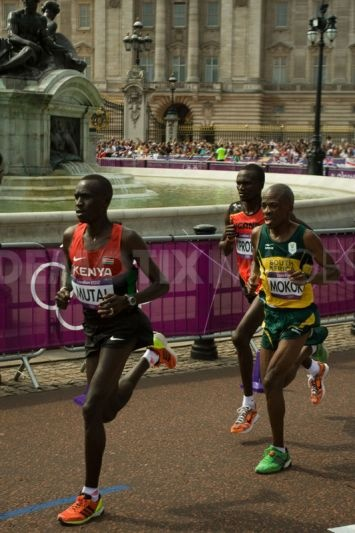 Emmanuel Kipchirchir Mutai, Stephen Mokoko and eventual Olympic Champion Stephen Kiprotich pass the 10 mile mark in the 2012 Olympic Marathon.
