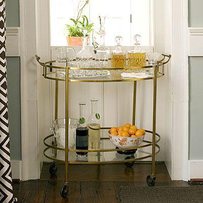 gold cart, seafoam walls, white trim, graphic fabric.