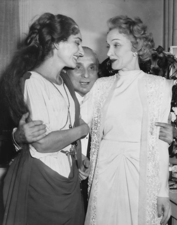 Marlene Dietrich meeting Maria Callas after a performance of Norma in 1957That's Callas' husband Giovanni Battista Meneghini sticking his face in between them
