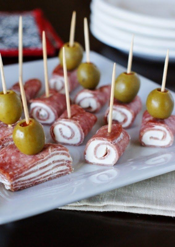 Use different types of olives and meats to wrap around cream cheese. A cheaper version could use lunch meat.