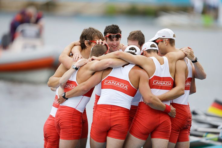 Canada's men's rowing eight celebrate after winning the silver medal in Eton Dorney, near Windsor, England, Aug. 1, 2012. (Chris Carlson/Associated Press)