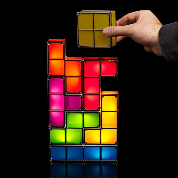 The Tetris Stackable LED Desk Lamp is a modular lamp that comes with seven Tetriminos, or Tetris blocks, in red, orange, yellow, green, blue, purple, and pink. The LED blocks light up when stacked together, and turn off when the lamp is disassembled. Available @ThinkGeek
