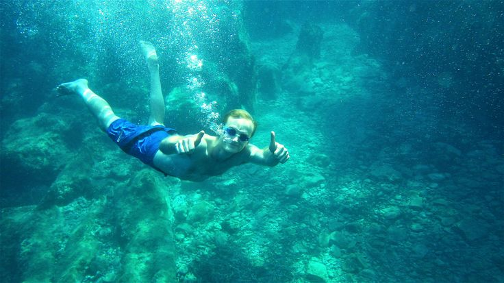 Swimming & Snorkeling Exploring the beautiful natural cave of Dassia in the crystal clear blue-green waters
