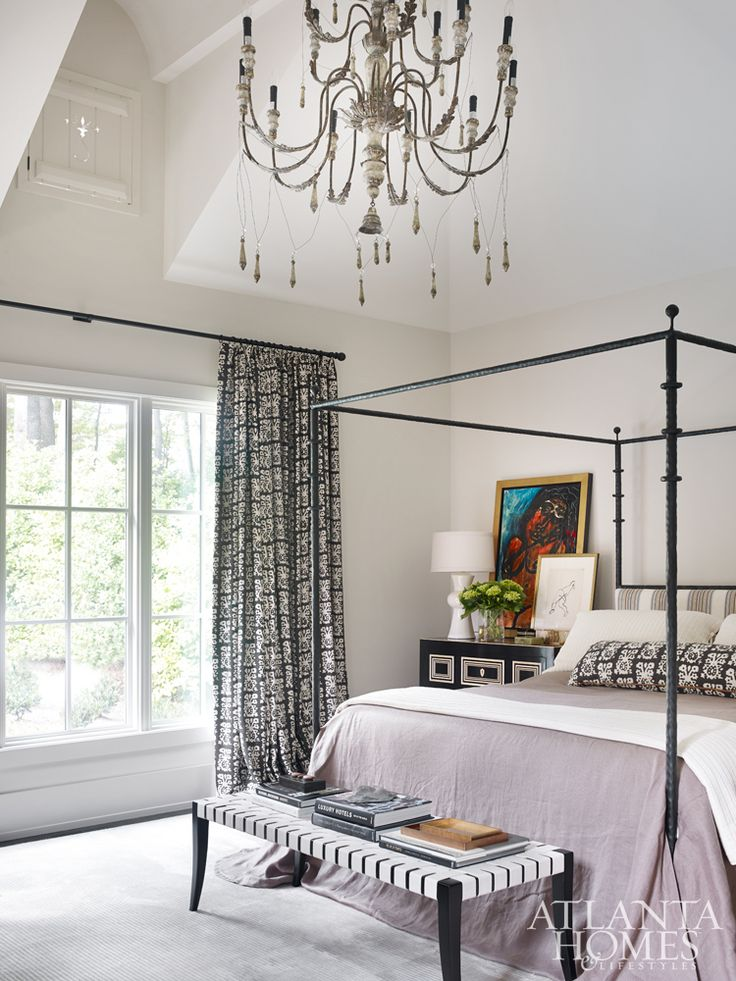 The master bedroom effortlessly mixes traditional and