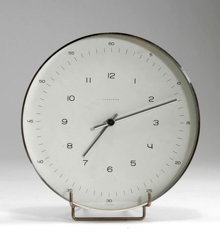 max bill; aluminum and glass 'atomat' wall clock for junghans, c. 1956.