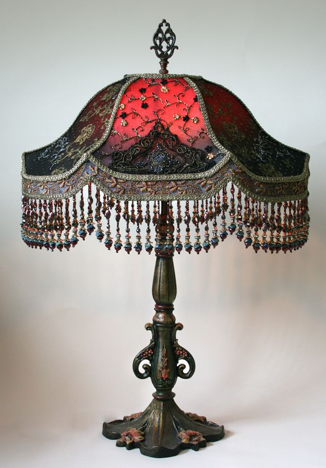 Pair Of Antique Ornate Metal Table Lamp Bases Hold Vader Shades Dyed Deep  Red To Dark Charcoal Gray. The Shades Are Covered In Period Nets I.