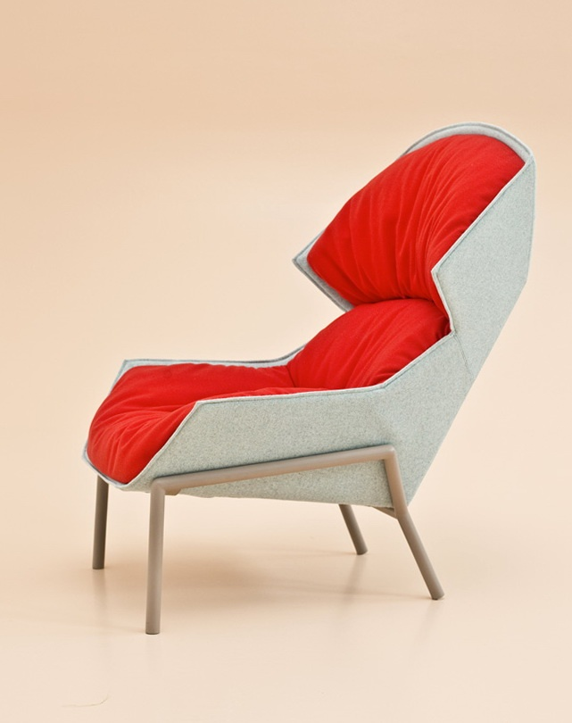 Patricia Urquiola  A beautiful, slightly alien looking armchair, that I want to snuggle up in. The bright red completes the drama of this chair.