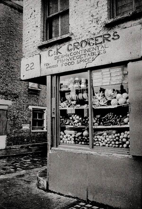 "C & K Grocers, Spitalfields, East End of London. ""From the floor to the roof, the shop was stocked full of everything you could imagine."" (1982)"