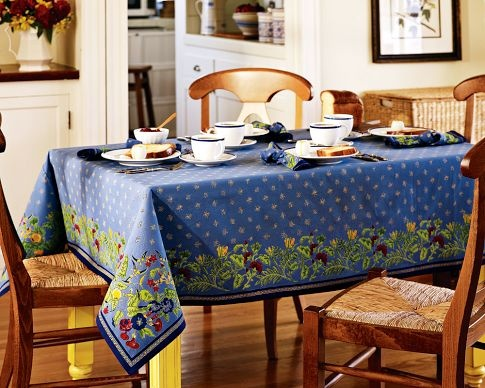 Love this tablecloth from William Sonoma. It looks great with my sunflower-yellow dining room walls.