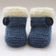These special little boots/bootees have been knitted with  lovely wool blend yarn in denim blue. They are edged with curly textured cream yarn and have a feature  button strap across the front. This is for decoration only. They are snug and comfortable...