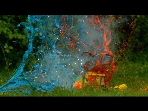 Slow Motion Video of Fireworks Exploding Inside Buckets Full of Paint