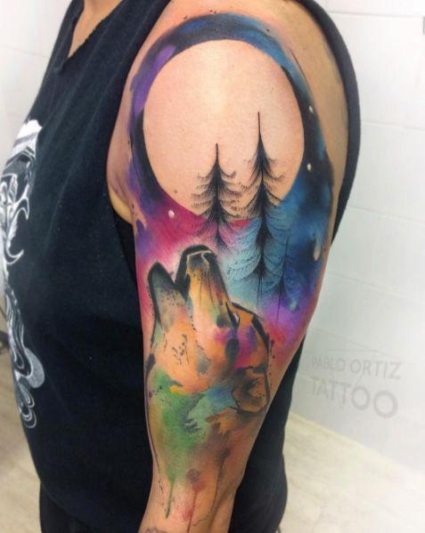 unique Animal Tattoo Designs - Watercolor wolf tattoo by Pablo Ortiz...
