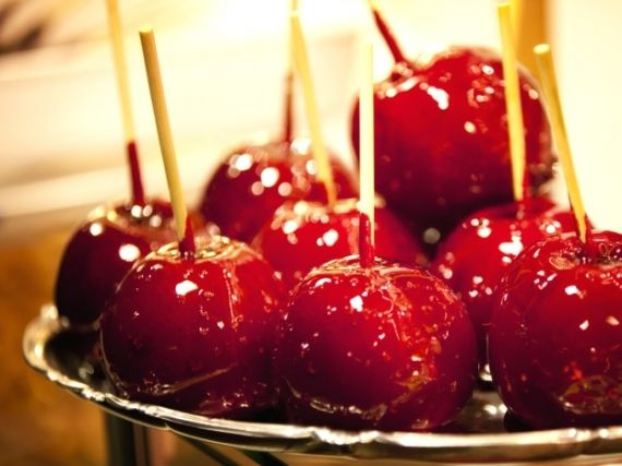 Candy apples (malus domestica). Twist the stalks off of 8 dry, unwaxed apples (or cover with boiling water to remove wax) and push a wooden skewer into each. Set 400g golden caster sugar and 100ml water over a med heat for 5 mins until dissolved, then stir in 1 tsp vinegar and 4 tbsp golden syrup. Set a sugar thermometer in the pan and boil to 140°C or 'hard crack' stage. Add red dye if desired. Quickly and carefully dip each apple in the hot toffee and place on baking paper to harden. Zone…