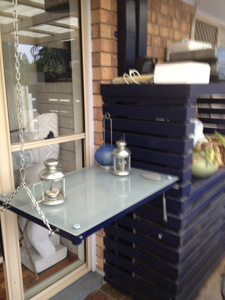table for entertaining- made from a glass door from Ikea (from their clearance area- some wood paint chain and hydrolic car hinge