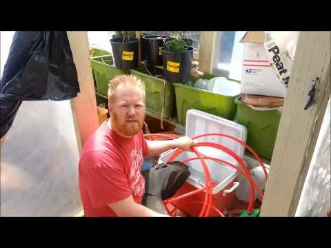 Greenhouse heater with outside woodburning stove - YouTube