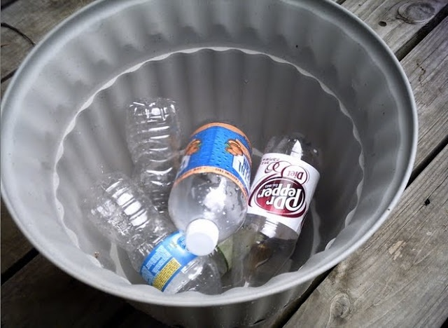 Instead of putting rocks in the bottom of big porch planters, fills the bottom with sealed empty plastic 20 ounce bottles! They give the pot the drainage it needs, without adding all that extra weight! So smart!!