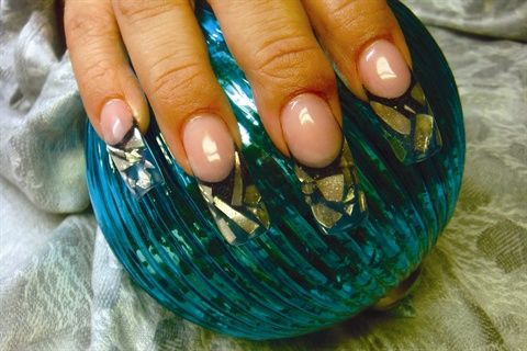 Embedding Christmas Ornaments in Acrylic Nails    In keeping with this holiday season, skilled nail tech and team Odyssey competitor Tammi Merritt shows how she uses pieces of broken Christmas ornaments to make shimmering and sparkling nail enhancements.