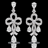Fabergé Soie Blanche Earrings    This piece is set in 18 carat white gold and features pear shaped white diamonds and round white diamonds.