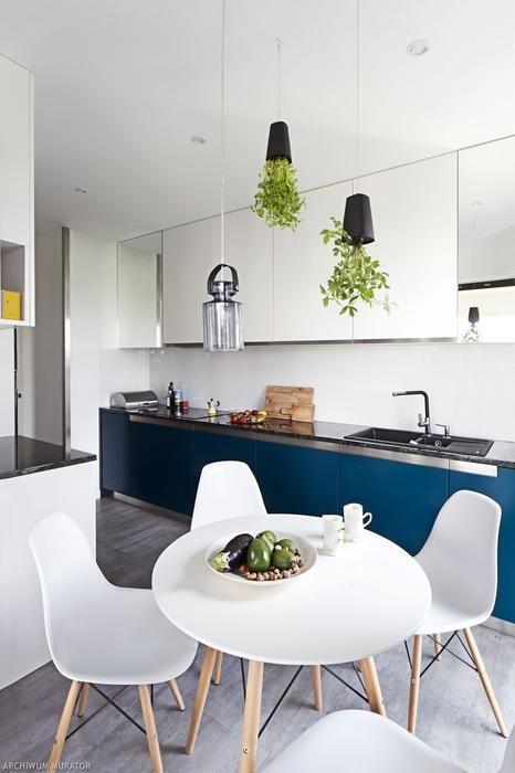 Projekt mieszkania z mchem naturalnym na ścianie.