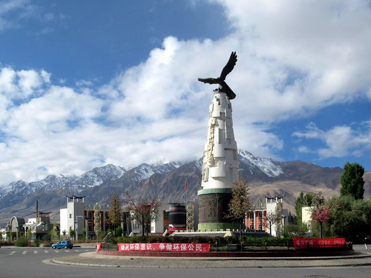 An eagle statue overlooks the main crossroads in Tashkurgan, Xinjiang, China. The snowcapped mountains west of the city form the border with Tajikistan.