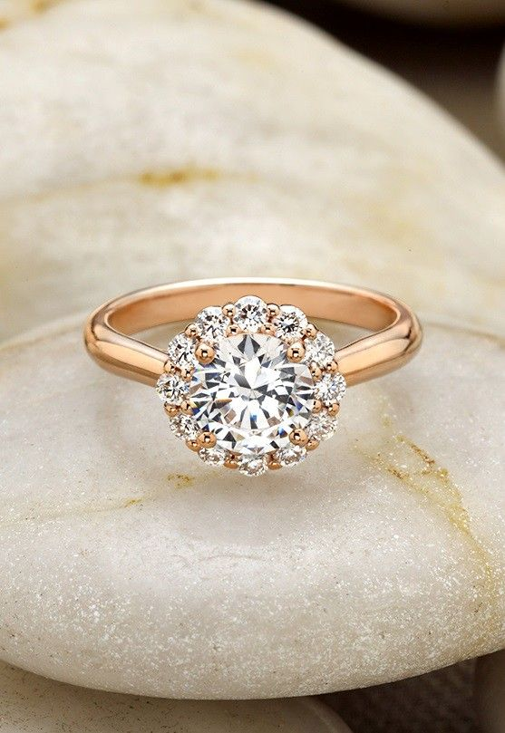 The subtle floral diamond halo blooms around the center diamond in this exquisite rose gold Brilliant Earth ring