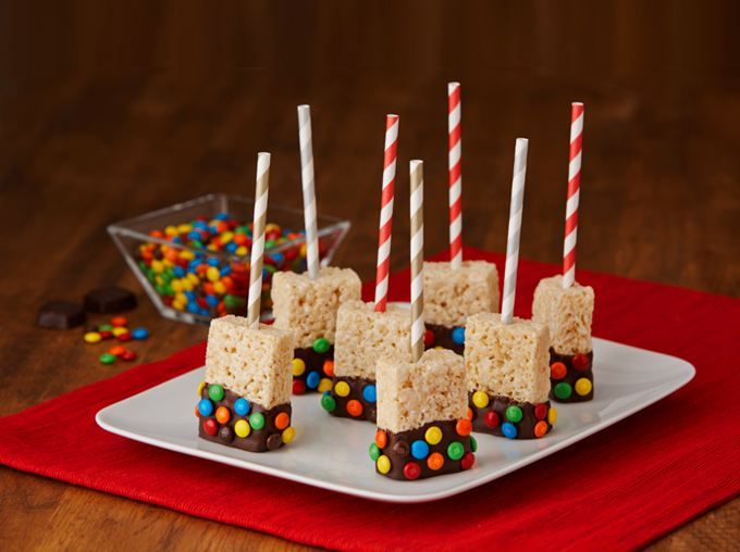 Rich dark chocolate and brightly-colored candies adorn these Rice Krispies Treats® on a stick.