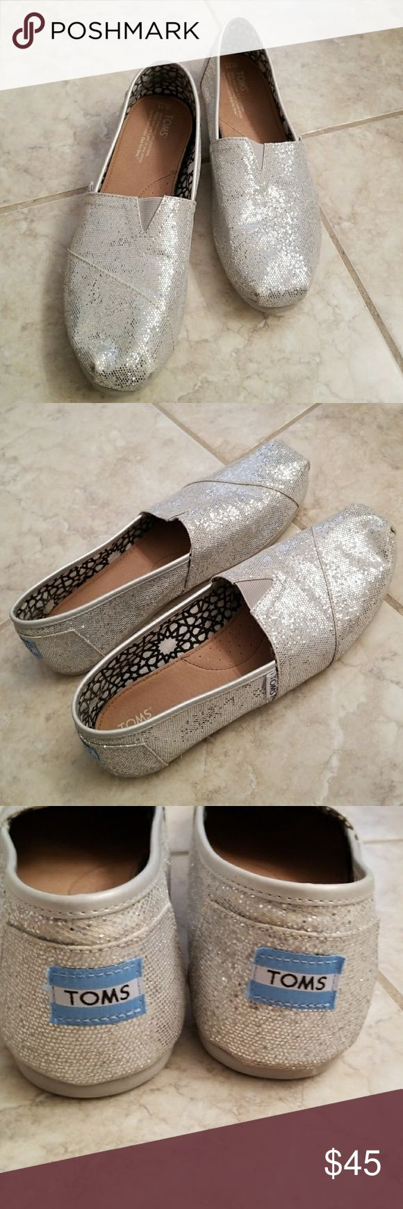Worn once silver glitter Toms size 11 Wore once for my wedding, only slightest wear on bottom sole, otherwise look brand new. Have original box. Toms Shoes Flats & Loafers