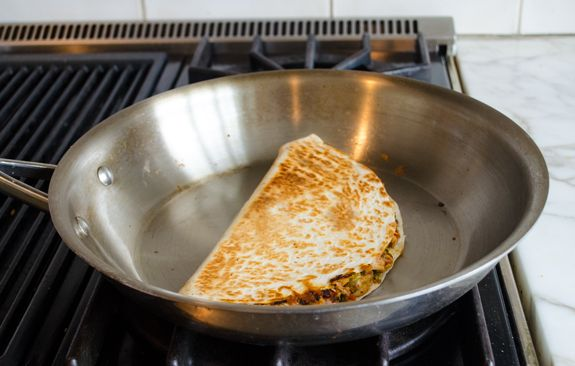 Warm and crisp flour tortillas filled with gooey melted cheddar, shredded chicken and a smoky chipotle-tomato sauce