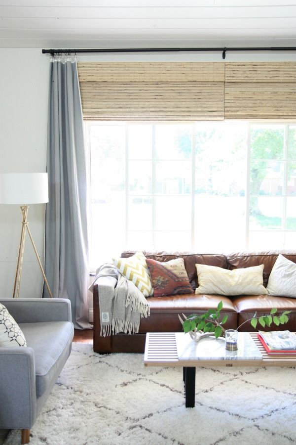 Leather couch + light pillows + gray+ woven blinds (to bridge the gap between window and curtain rod) | House Tweaking