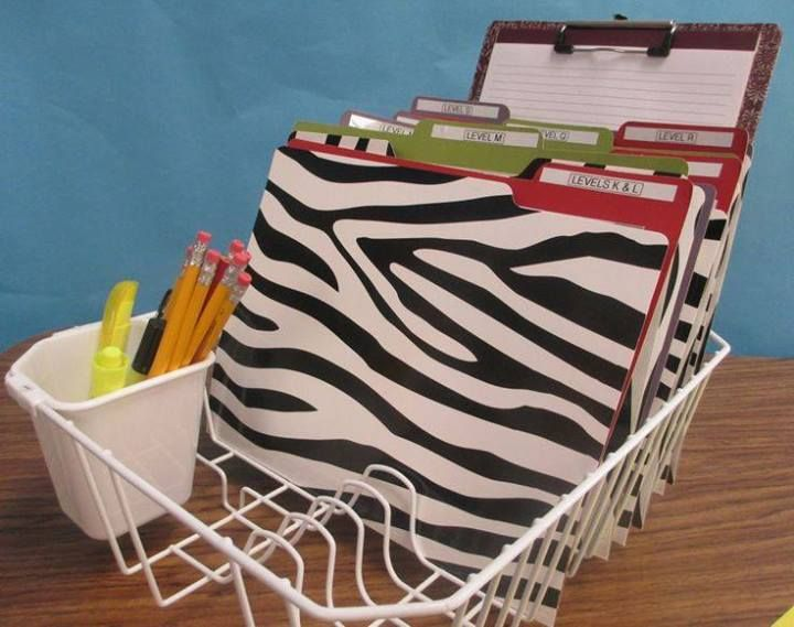 classroom organization for teacher's desk--use a kitchen dish strainer to hold files, pens, pencils, etc.