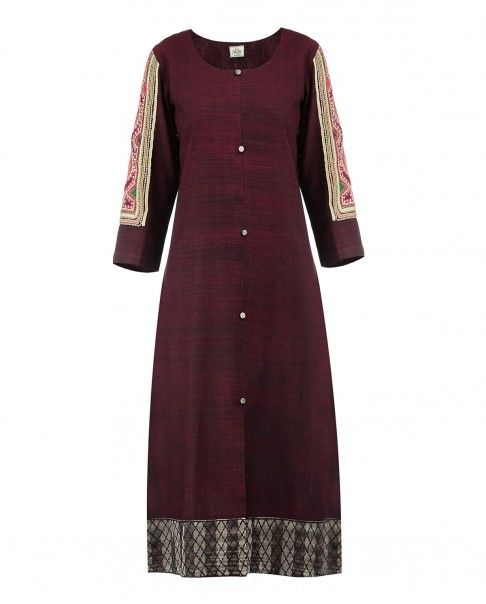 Oxblood tunic with round neckline, central slit and front button placket. Thread embroidery and mirror work adorn the three quarter sleeves. Gray hemline with thread stitching accents. Wash Care: Dry clean onlyChuridar leggings worn by the model are only for styling purpose