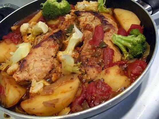 ingredients:    2 (6 ounce) boneless pork chops  1 large onion, sliced  1 (14 1/2 ounce) can stewed tomatoes, we like Italian flavored  2 medium potatoes, peeled and quartered…  1/2 cup broccoli spear  1/2 cup cauliflower, spears  salt and pepper  vegetable oil cooking spray    Directions:  Spray