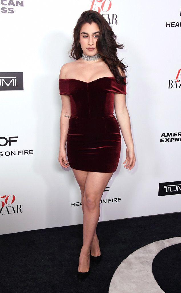 Lauren Jauregui from Harper's Bazaar's 150 Most Fashionable Women Event The Fifth Harmony singer wears a shoulder-baring burgundy velvet mini dress.