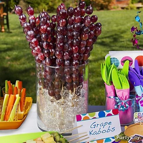 Although these grape kabobs are shown in a casual setting, they would be fabulous on a more formal table with bottles of wine and cheese and charcuterie trays. You could even replace the icecubes with fake acrylic clear cubes and put a colored electric tea candle in the bottom for a cool more modern effect!