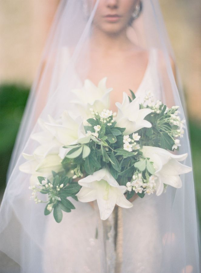 Ivory amaryllis and greenery wedding bouquet: http://www.stylemepretty.com/2014/03/26/an-italy-workshop-the-wedding-inspiration/ Photography: Jose Villa - http://josevillablog.com/