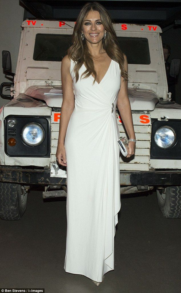 Belle of the ball! Elizabeth Hurley, 50, wowed in white at the first ever City Veterans' N...